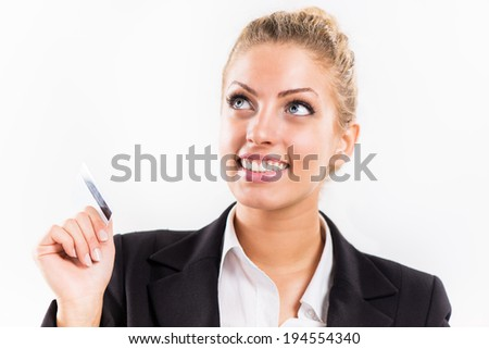 Smiling Businesswoman holding a credit card.
