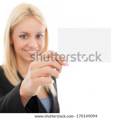 Smiling businesswoman holding blank business card.  Focus on blank business card. - stock photo