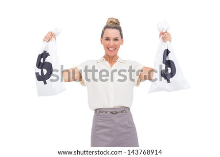 Smiling businesswoman holding money bags with hand