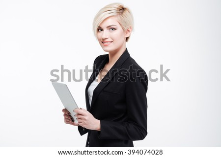 Smiling businesswoman holding tablet computer isolated on a white background - stock photo