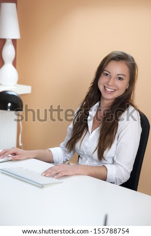 Smiling businesswoman in her office - stock photo