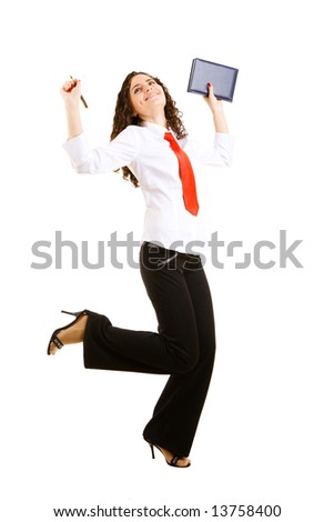 smiling businesswoman jumps with a pan and a book - stock photo