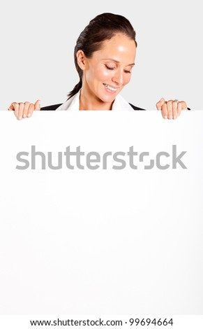 smiling businesswoman looking down white board