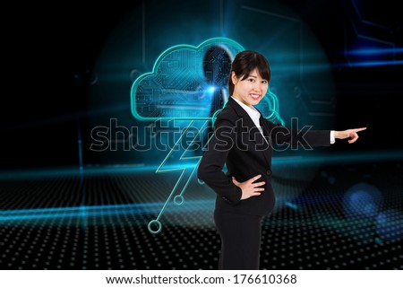 Smiling businesswoman pointing against keyhole on technological background
