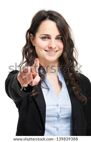 Smiling businesswoman pointing her finger at you  - stock photo