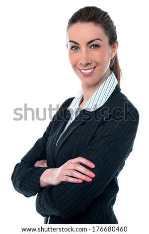 Smiling businesswoman posing with folded arms - stock photo