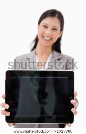 Smiling businesswoman presenting tablet screen against a white background - stock photo