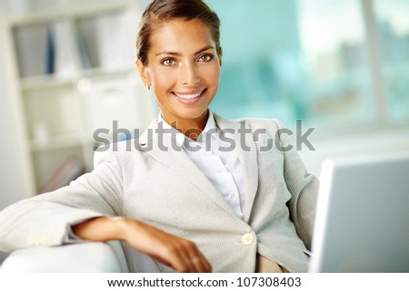 Smiling businesswoman representing positive attitude and success in business