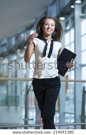Smiling businesswoman runs towards camera