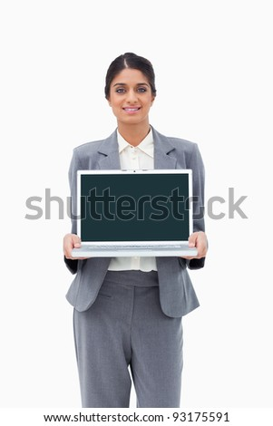 Smiling businesswoman showing her laptop against a white background