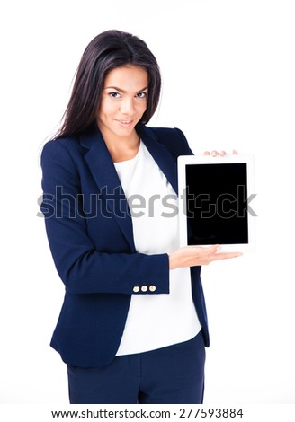 Smiling businesswoman showing tablet computer screen over white background. Looking at camera - stock photo