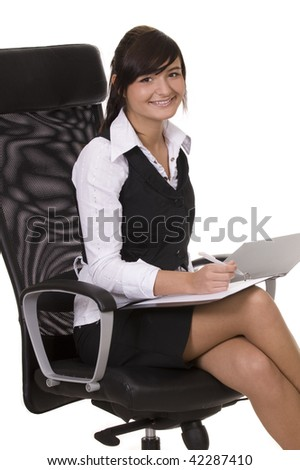 smiling businesswoman sitting on the office chair - stock photo