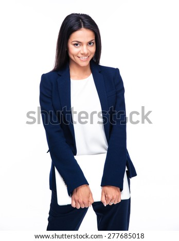 Smiling businesswoman standing with laptop over white background. Looking at camera - stock photo