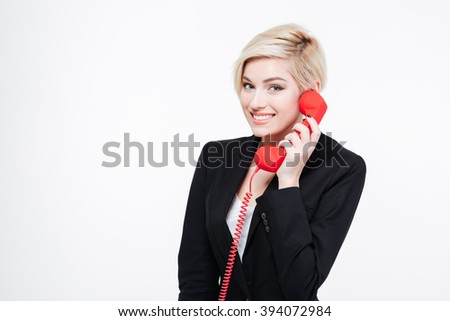 Smiling businesswoman talking on the phone tube isolated on a white background - stock photo