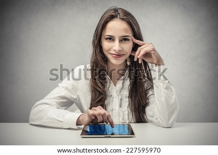 Smiling businesswoman using a tablet  - stock photo