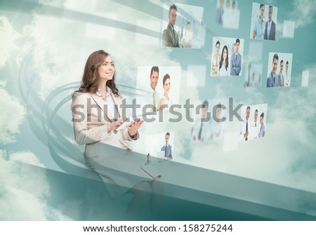Smiling businesswoman using digital interface while cloud computing