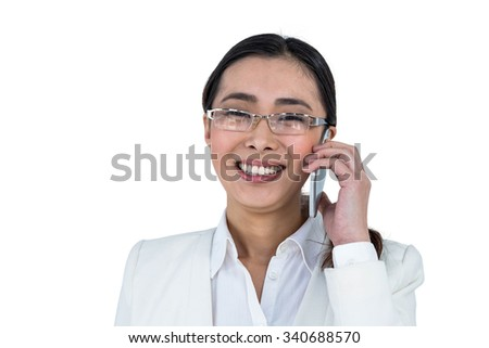 Smiling businesswoman using her smart phone against white background
