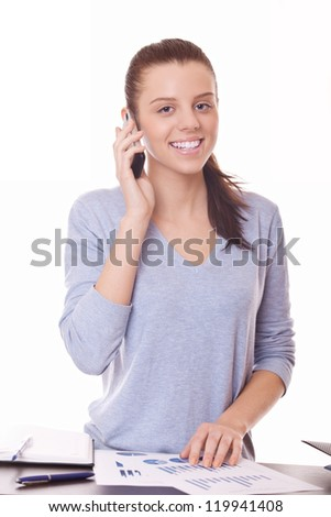 smiling businesswoman with documents and calls on mobile phone - stock photo