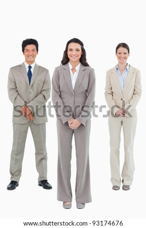Smiling businesswoman with her team behind her against a white background