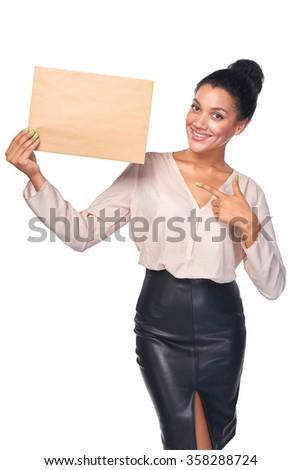 Smiling businesswoman with parcel over white background, pointing at it - stock photo