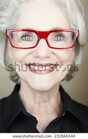Smiling Businesswoman with Red Glasses