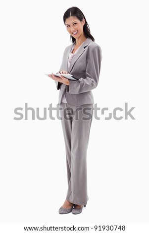 Smiling businesswoman with tablet against a white background