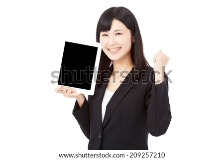 smiling businesswoman with the tablet