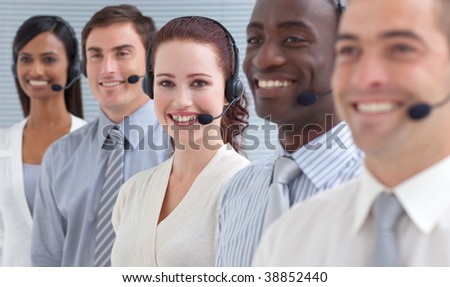 Smiling businesswoman working in a call center standing in a line