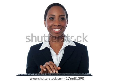 Smiling businesswoman working in computer keyboard - stock photo