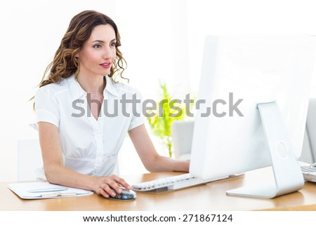 Smiling businesswoman working with computer on white background