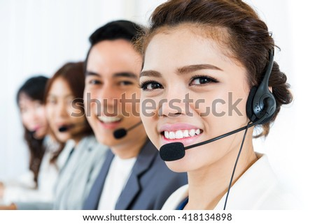 Smiling call center team - customer service, telemarketer and operator concepts