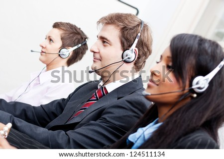 smiling callcenter agent with headset support hotline - stock photo