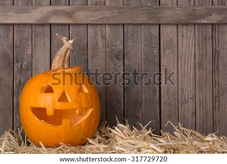 Smiling carved pumpkin on a wood background - stock photo