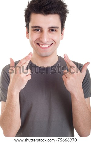 smiling casual man with crossed fingers isolated on white background