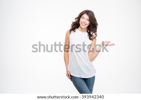 Smiling casual woman holding copyspace on the palm isolated on a white background - stock photo