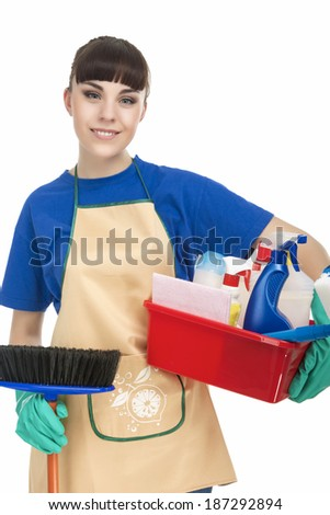 Smiling Caucasian Female Servant With Cleaning Accessories. isolated Over White. Vertical Image - stock photo