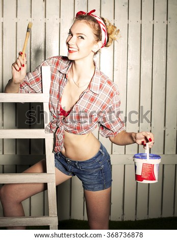 Smiling caucasian pin-up girl with brush and paint  - stock photo
