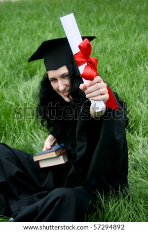 Smiling Caucasian student with diploma - stock photo