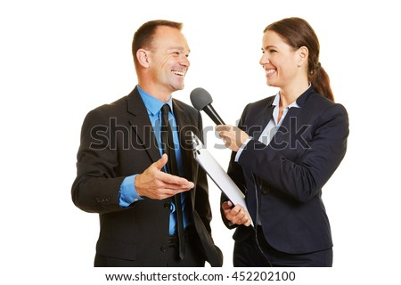 Smiling CEO of business company giving interview to media journalist - stock photo