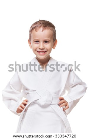 Smiling charming kid in brand new kimono on isolated white - stock photo