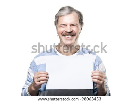 smiling cheerful mature man holding a blank billboard isolated on white background