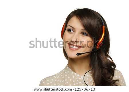Smiling cheerful support phone operator woman in headset looking to the side at blank copy space, isolated on white background