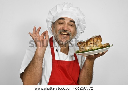 smiling chef in red apron with red apron