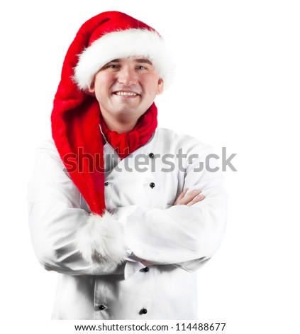 Smiling chef in Santa hat isolated on white