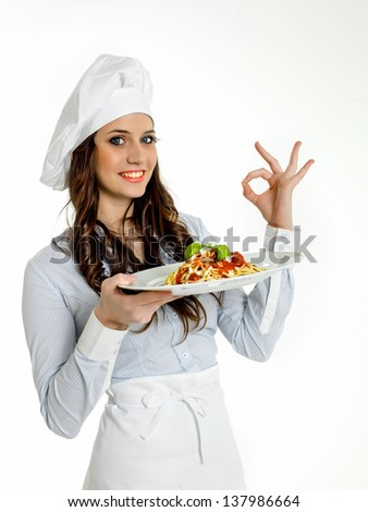 Smiling chef with a dish of  italian spaghetti - stock photo