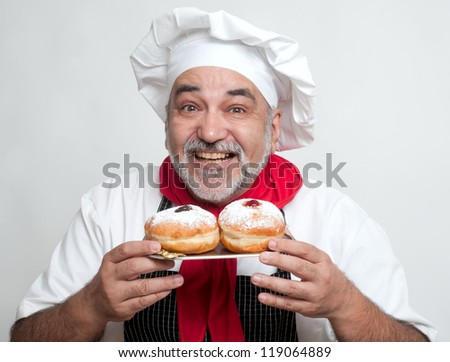 smiling chef with  hanukkah doughnut