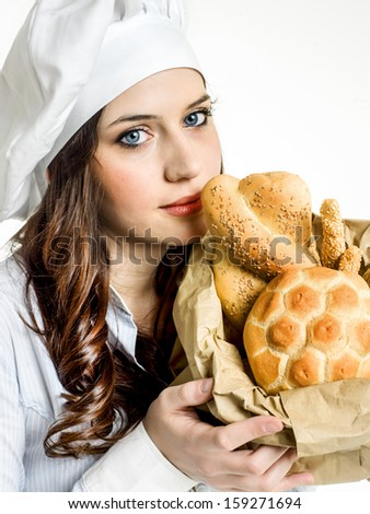 smiling chef with italian bread - stock photo