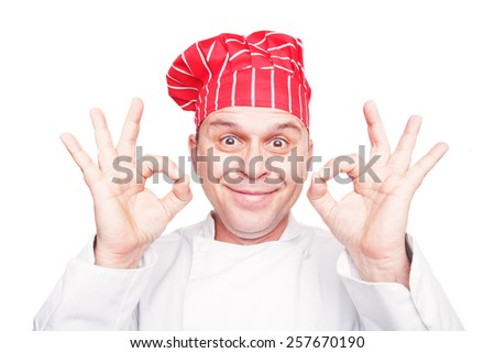 Smiling chef with red hat, isolated on white background - stock photo