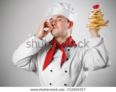 Smiling chef with sweet christmas tree