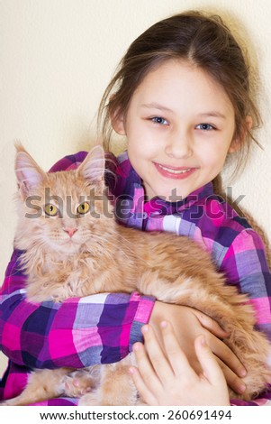 smiling child and kitten, maine coon - stock photo